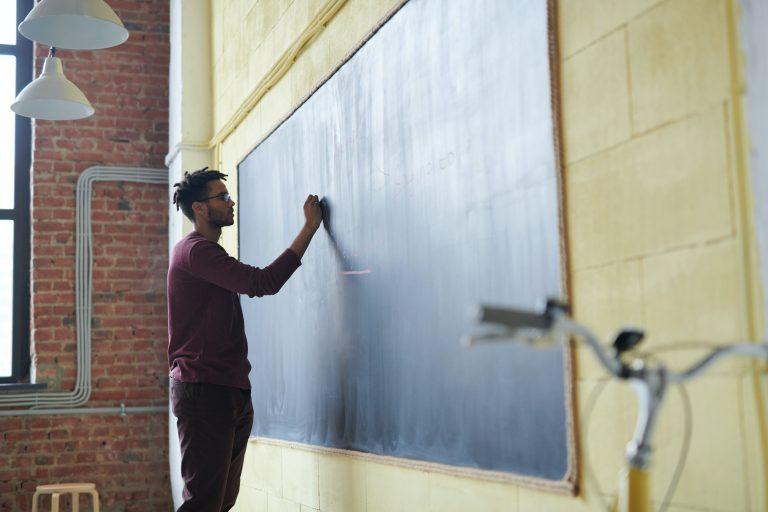 man-writing-on-a-blackboard-3184658